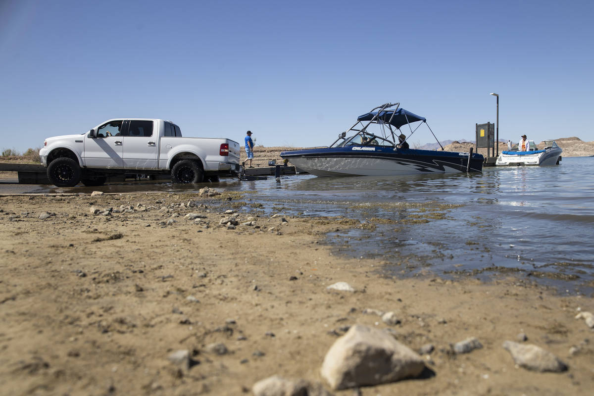 A boat is moved to the water at Hemenway Harbor in Boulder City on Wednesday, May 5, 2021. (Eri ...