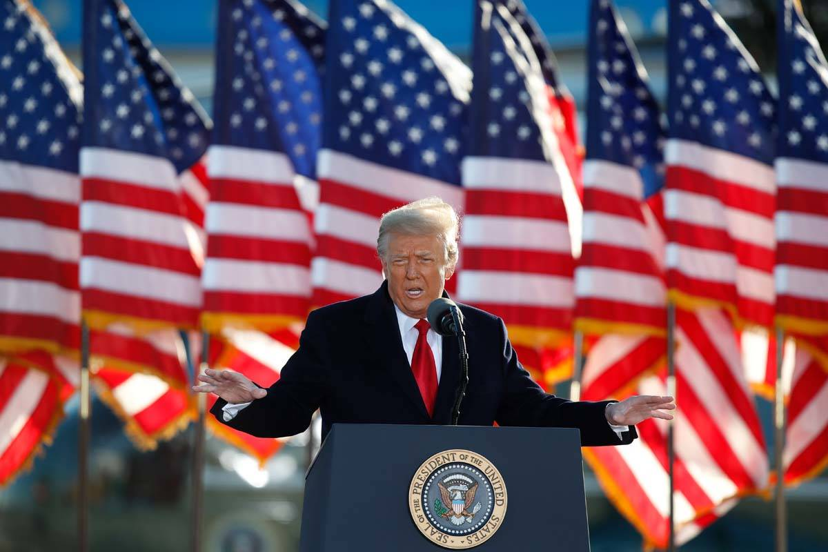 President Donald Trump speaks to crowd before boarding Air Force One at Andrews Air Force Base, ...
