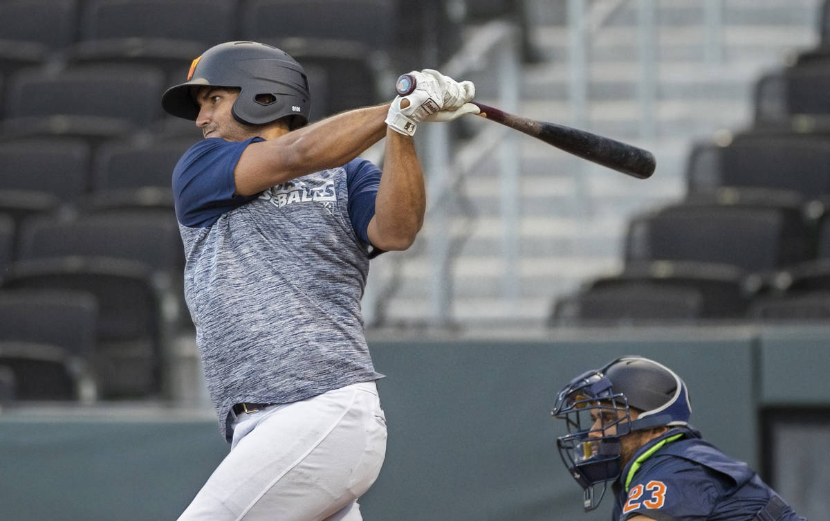 Aviators first baseman Edwin Diaz takes a swing during a simulated game at practice on Tuesday, ...