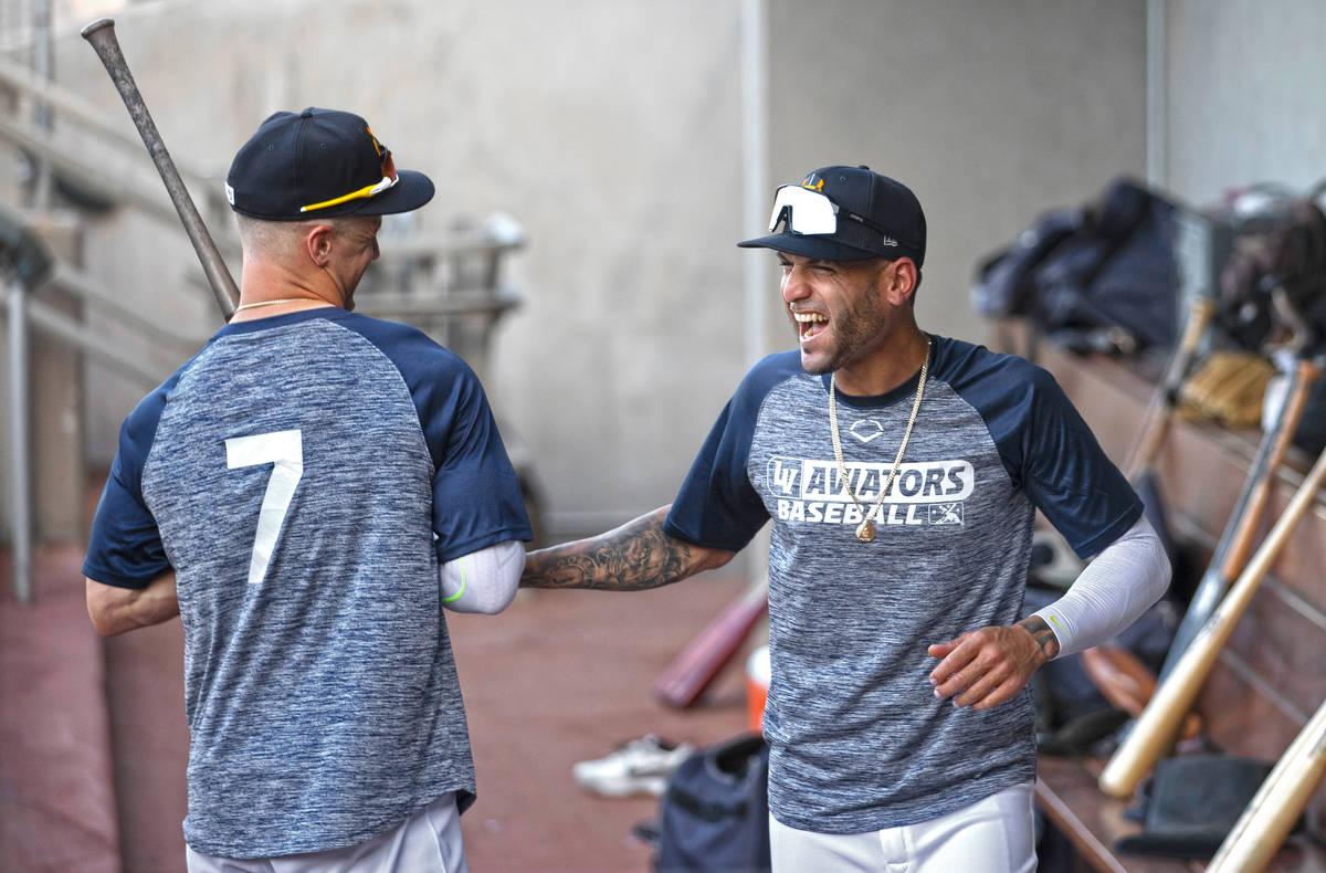 Aviators outfielder Luis Barrera, right, jokes around with teammate Greg Deichman during practi ...