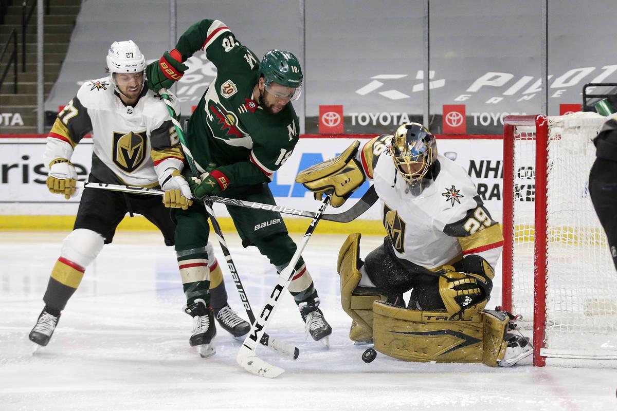 Vegas Golden Knights goaltender Marc-Andre Fleury (29) blocks a shot by Minnesota Wild left win ...