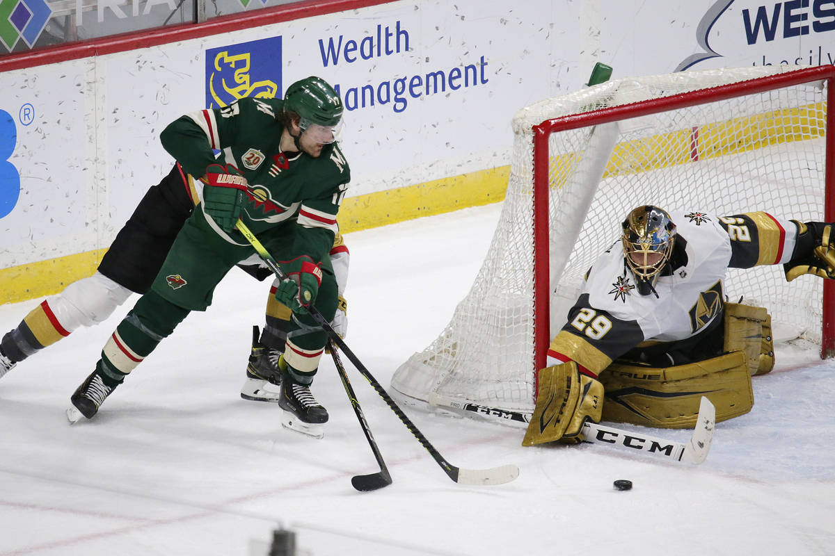 Vegas Golden Knights goaltender Marc-Andre Fleury (29) stops a shot by Minnesota Wild left wing ...