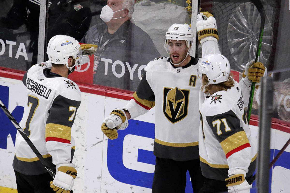 Vegas Golden Knights right wing Reilly Smith (19) is congratulated by defenseman Alex Pietrange ...