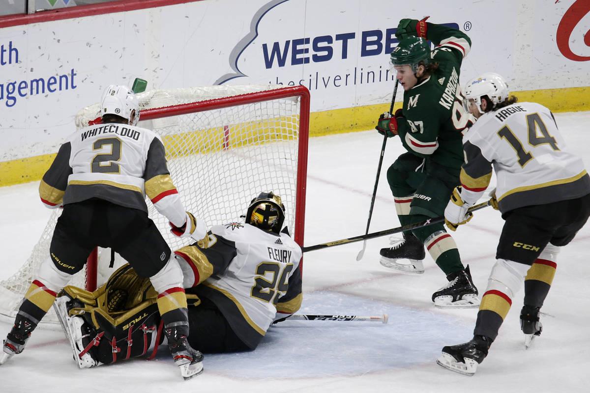 Minnesota Wild left wing Kirill Kaprizov (97) scores a goal on Vegas Golden Knights goaltender ...
