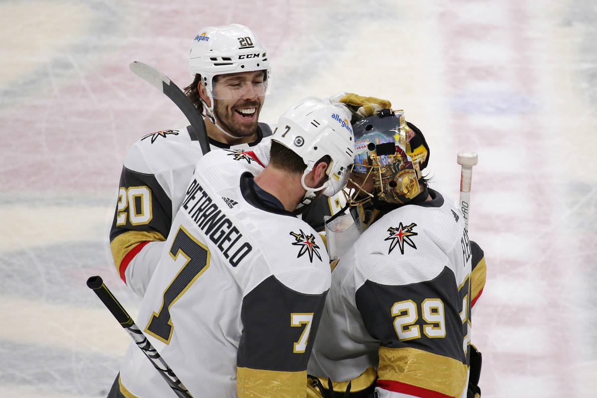 Vegas Golden Knights defenseman Alex Pietrangelo (7) congratulates goaltender Marc-Andre Fleury ...