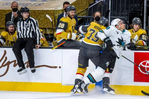 Golden Knights right wing Ryan Reaves (75) checks San Jose Sharks right wing Timo Meier (28) ha ...