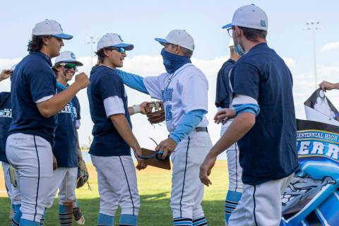 Centennial High School's baseball coach Charlie Cerrone reaches to hug senior Dominic Perez aft ...
