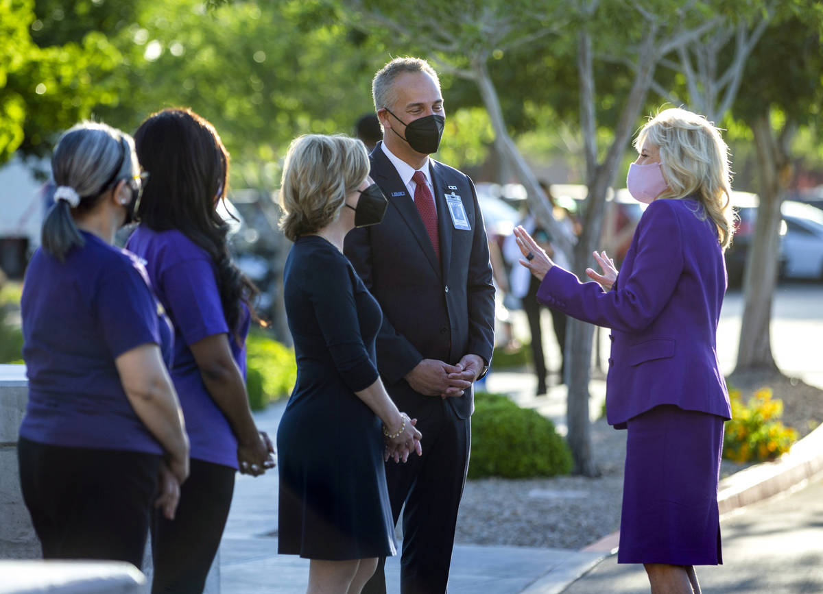 First Lady Jill Biden, from right, is greeted by University Medical Center CEO Mason Van Houwel ...