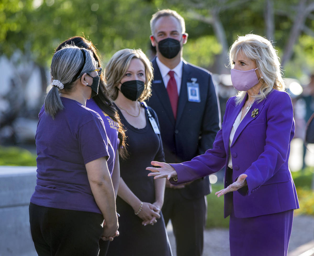 First Lady Jill Biden, from right, with University Medical Center CEO Mason Van Houweling and C ...