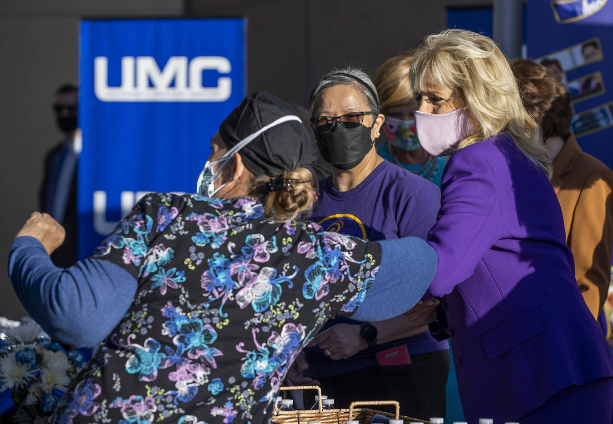 First Lady Jill Biden shares an elbow bump with a nurse at the University Medical Center while ...