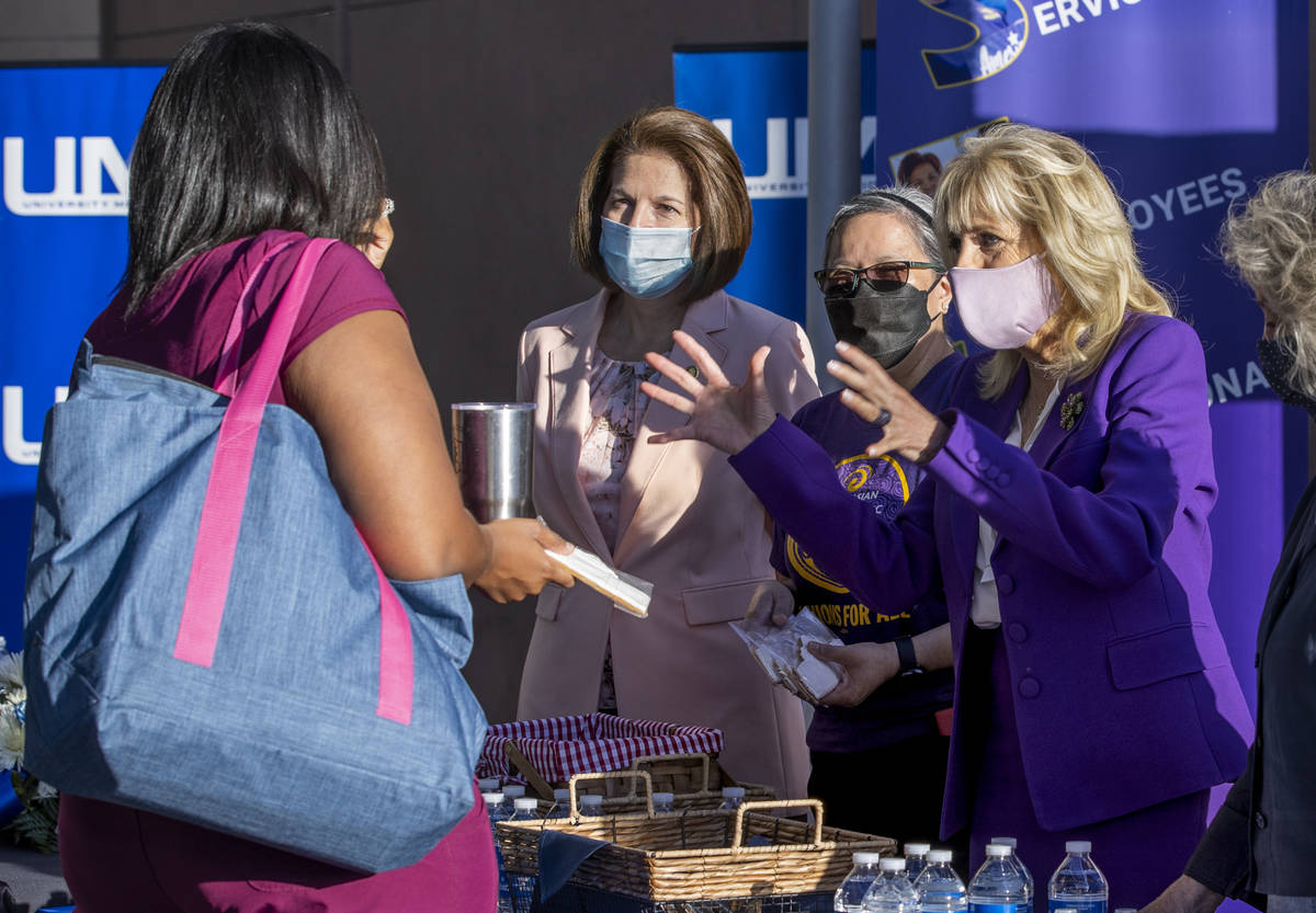 First Lady Jill Biden, right, talks with medical resident Briana Gonner, left, at the Universit ...