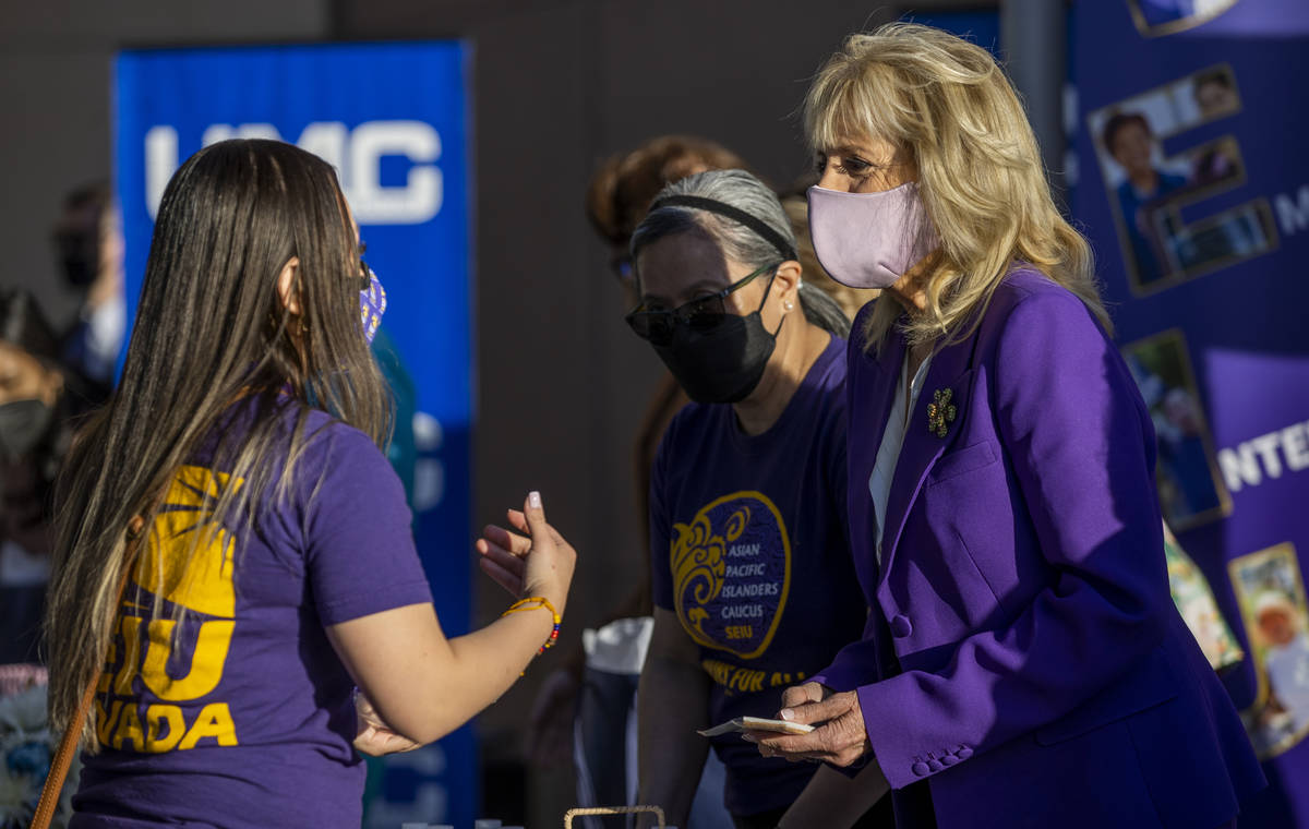 First Lady Jill Biden talks with a staff person at the University Medical Center joining the Se ...
