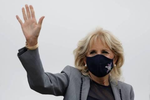First lady Jill Biden waves as she arrives in Salt Lake City International Airport in Salt Lake ...