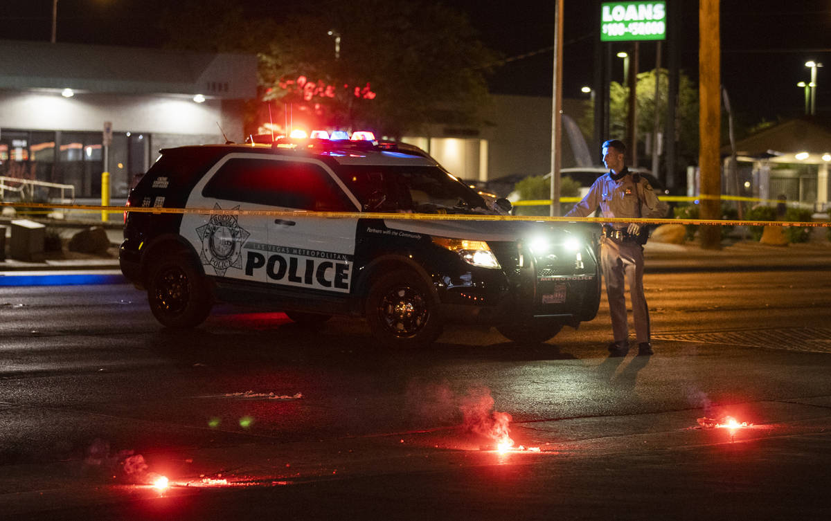 Officers investigate a fatal hit-and-run crash in northeast Las Vegas close to East Lake Mead B ...