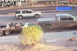 Police described the truck involved in Wednesday's hit-and-run as a newer dark gray GMC crew ca ...