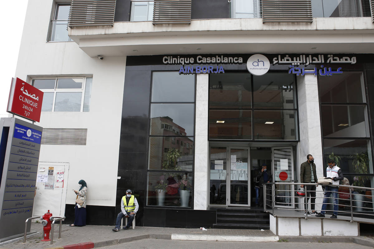 People wait in front of the Ain Borja private clinic in Casablanca, Morocco, Wednesday, May 5, ...