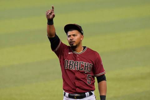 Arizona Diamondbacks' Eduardo Escobar (5) waves before a baseball game against the Miami Marlin ...