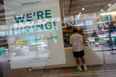 A signs announcing they are hiring hangs in the window of a restaurant in the Greenwich Village ...