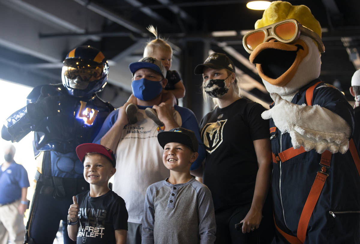 Aviator, left, Bowen, Jeremiah, Oakley, Ryder and Taylor Gutierrez pose with Spruce the Goose b ...