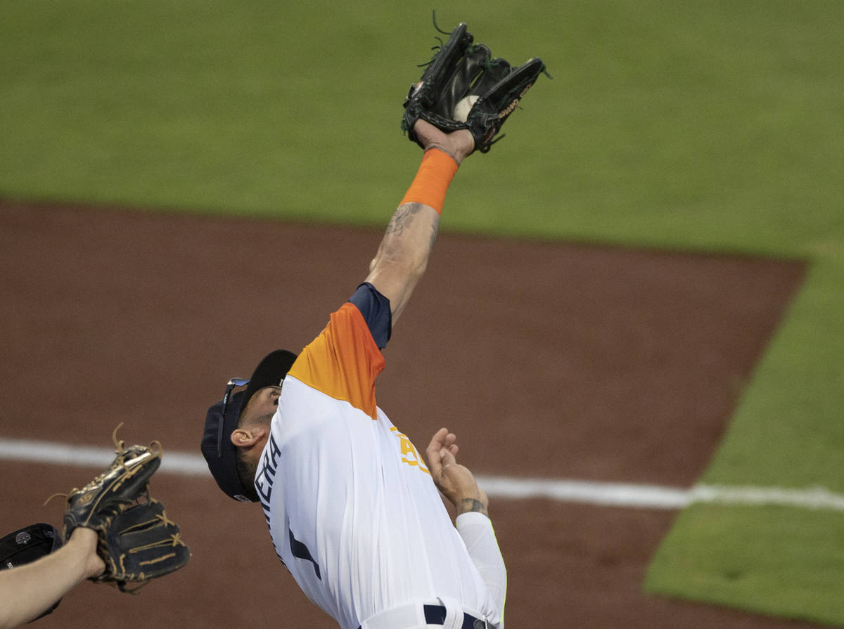Las Vegas Aviators outfielder Luis Barrera (1) makes a diving catch in the bottom of the third ...