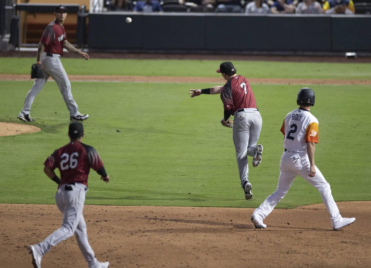 Sacramento River Cats infielder Mitchell Tolman (7) makes a leaping throw past Las Vegas Aviato ...