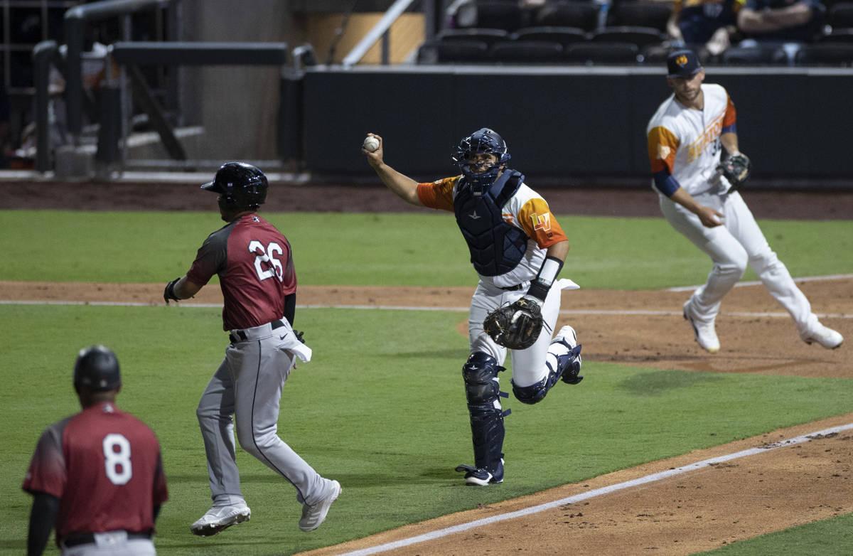 Las Vegas Aviators catcher Carlos Prez (23) chases Sacramento River Cats infielder Thairo ...