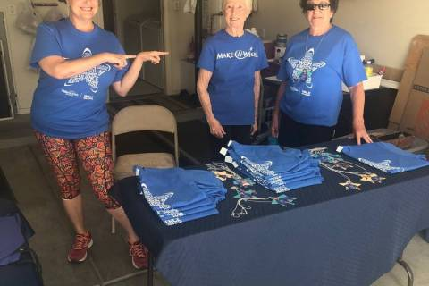 Cottonwood Terrace resident Ruth Furman and friends distribute specialty T-shirts to residents ...