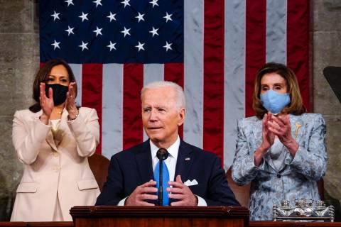 Vice President Kamala Harris and House Speaker Nancy Pelosi of Calif., stand and applaud as Pre ...