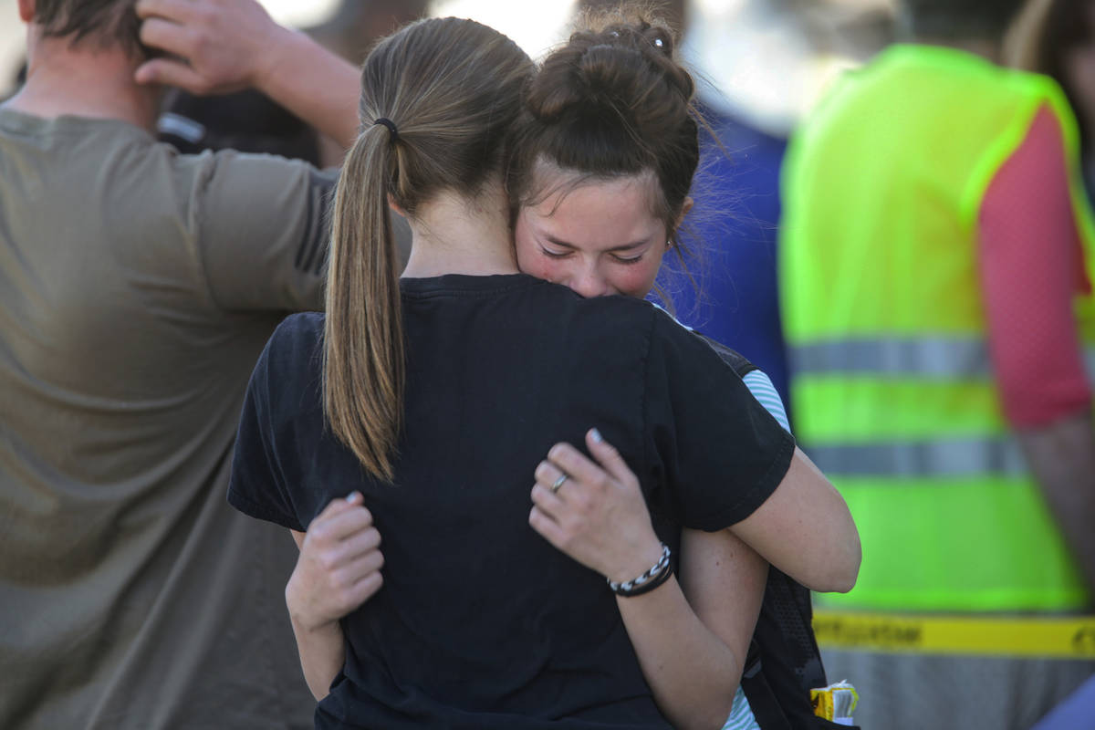 Students embrace after a school shooting at Rigby Middle School in Rigby, Idaho on Thursday, Ma ...