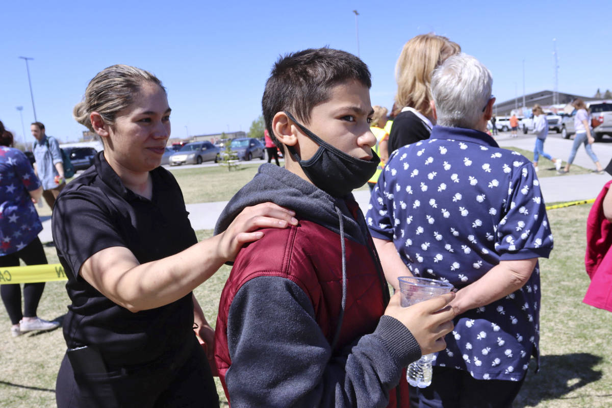 Adela Rodriguez, left, walks with her son, Yandel Rodriguez, 12, at the high school where peopl ...