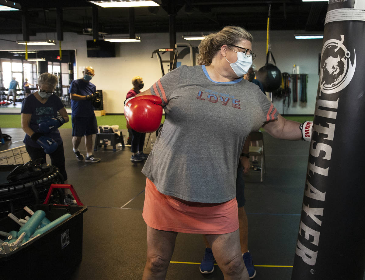 Gwen Vaughn, 48, punches the bag during her first boxing class at Tony Cress Training Center, o ...