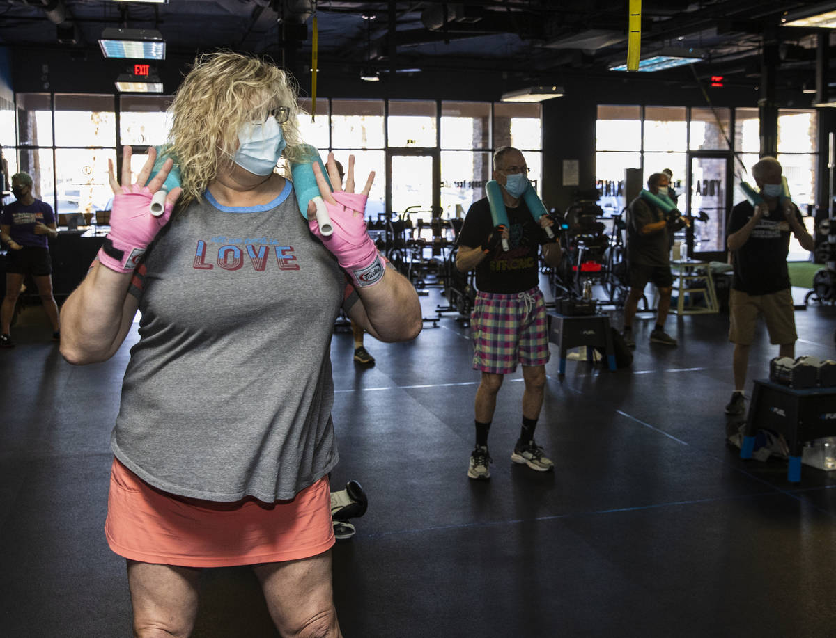 Gwen Vaughn, 48, warms up prior to her first boxing class at Tony Cress Training Center, on Fri ...