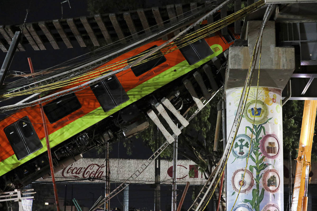 Mexico City's subway cars lay at an angle after a section of Line 12 of the subway collapsed in ...