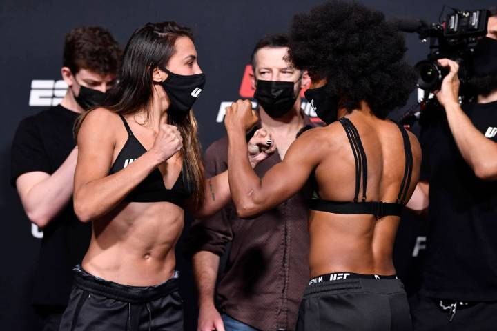 Amanda Ribas, left, of Brazil and Angela Hill face off during the UFC weigh-in at UFC APEX on M ...