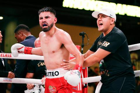 Jose Ramirez celebrates a TKO against Maurice Hooker after six rounds of a boxing match, Saturd ...