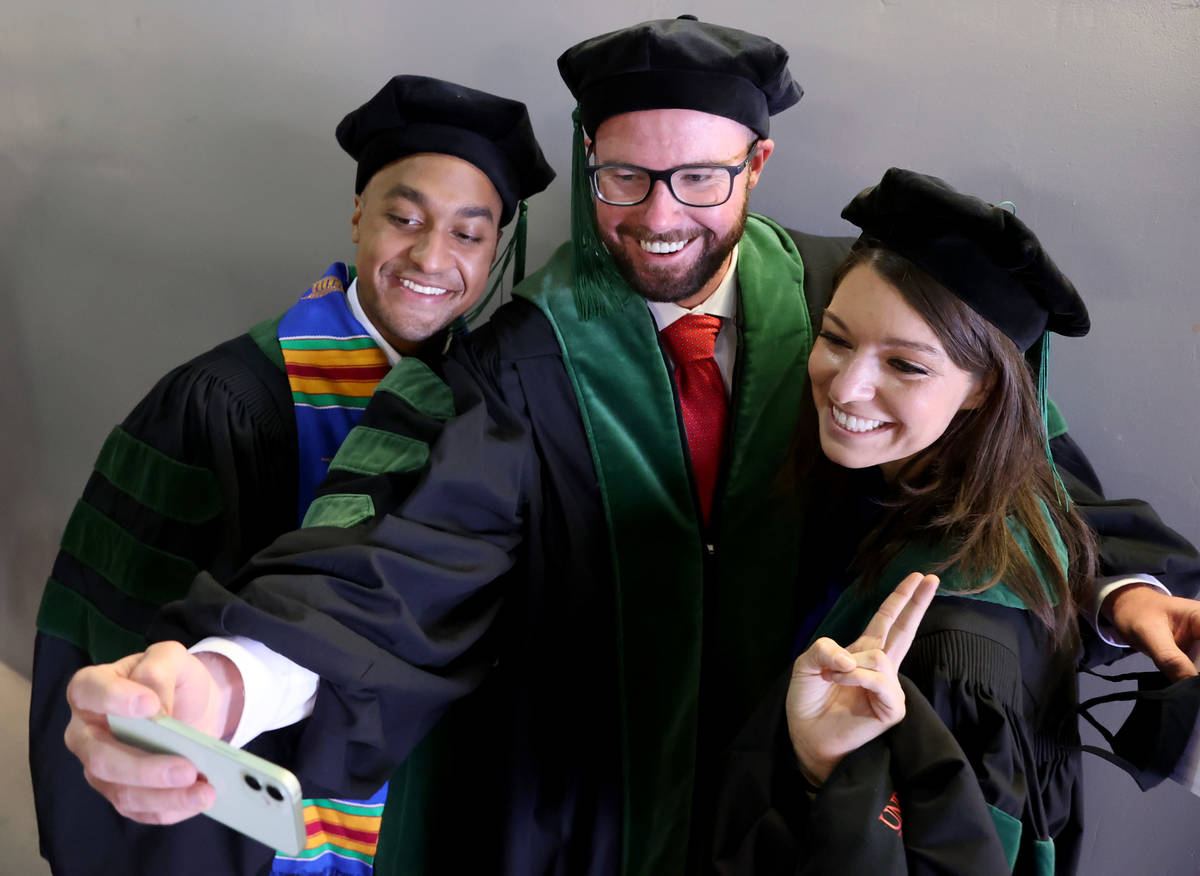 Members of the first graduating class of medical doctor students from the Kirk Kerkorian School ...