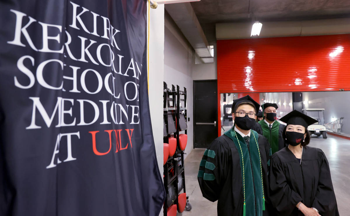 Toyokazu Endo and his mother Masae Endo, who will be doing his hooding, before the graduation c ...