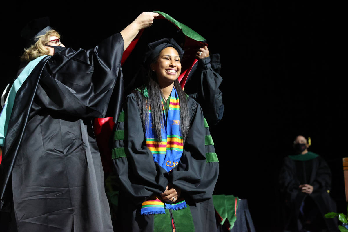 Lauren Hollifield is hooded as part of the first graduating class of medical doctor students fr ...
