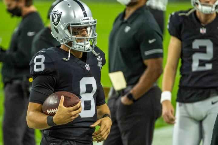 Raiders quarterback Marcus Mariota (8) wanders the sidelines versus the Miami Dolphins during t ...