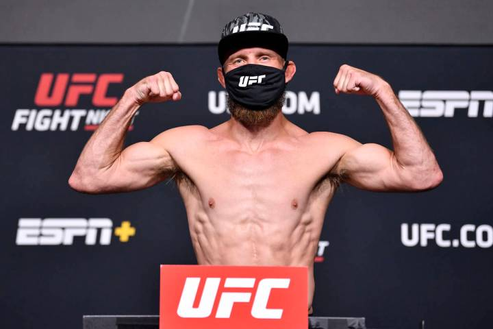 Donald 'Cowboy' Cerrone poses on the scale during the UFC weigh-in at UFC APEX on May 07, 2021 ...