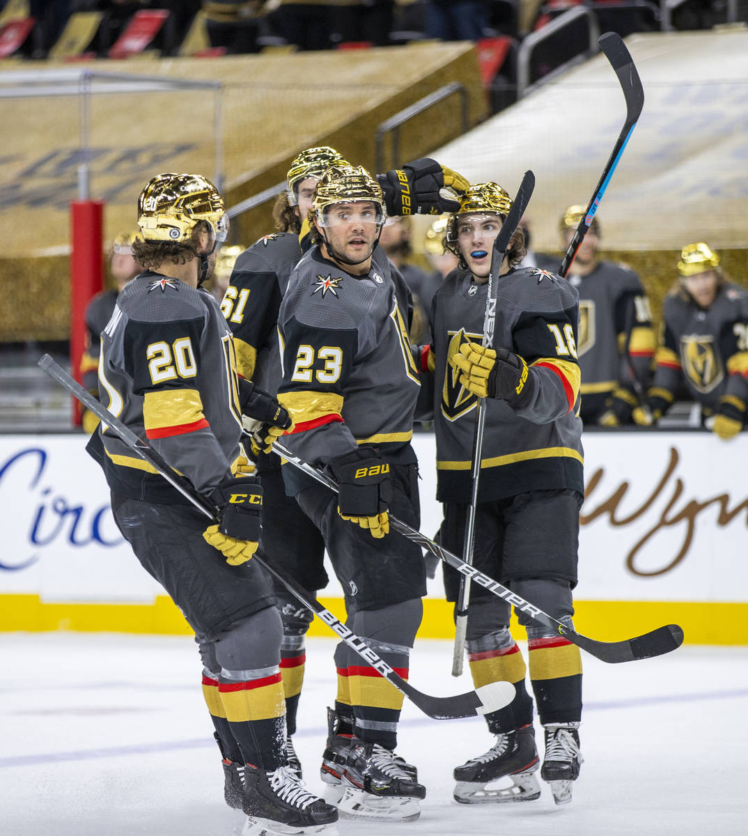 Golden Knights defenseman Alec Martinez (23) is celebrated with teammates for a goal over the S ...