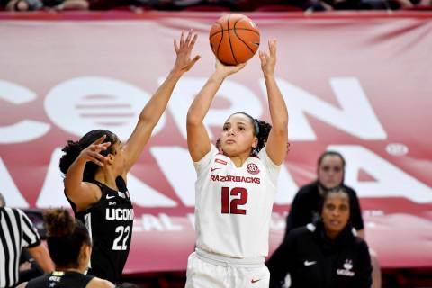 Arkansas guard Destiny Slocum (12) shoots over Connecticut defender Evina Westbrook (22) during ...