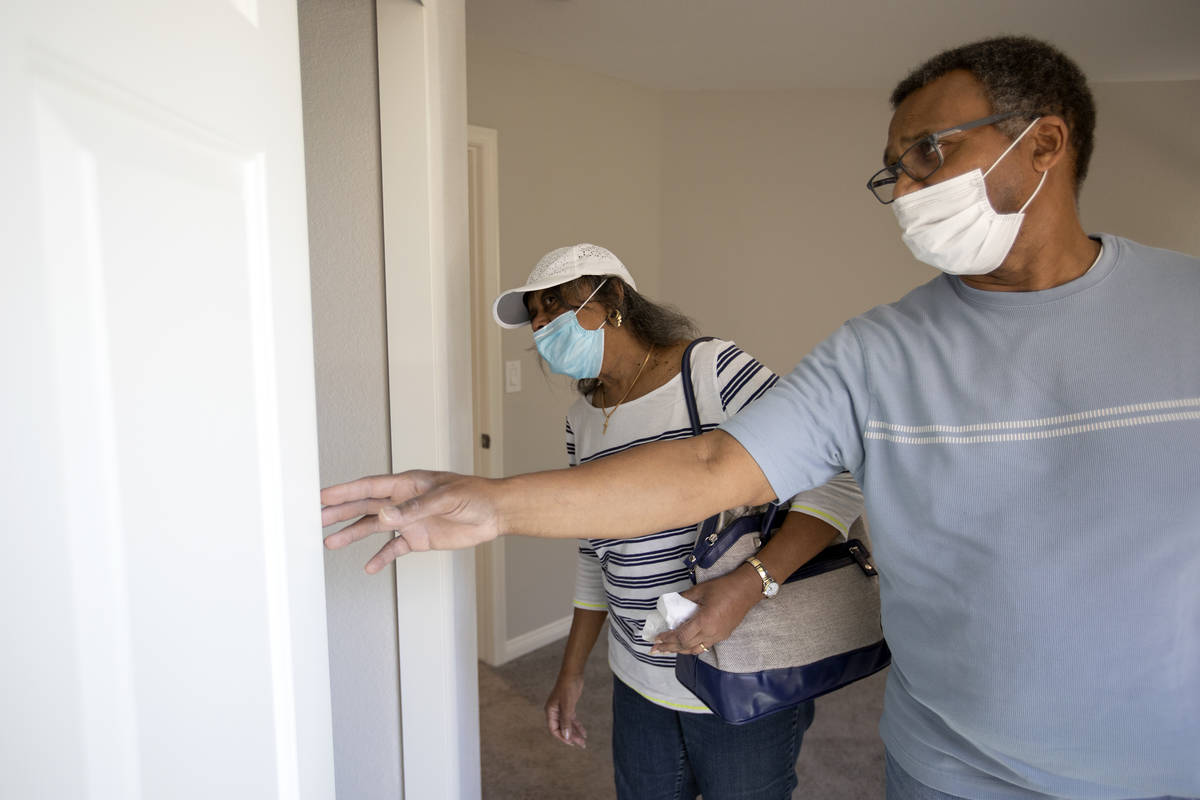 Evelyn Williams and Daryl Williams check out the closet space during an open house at 2412 Crag ...