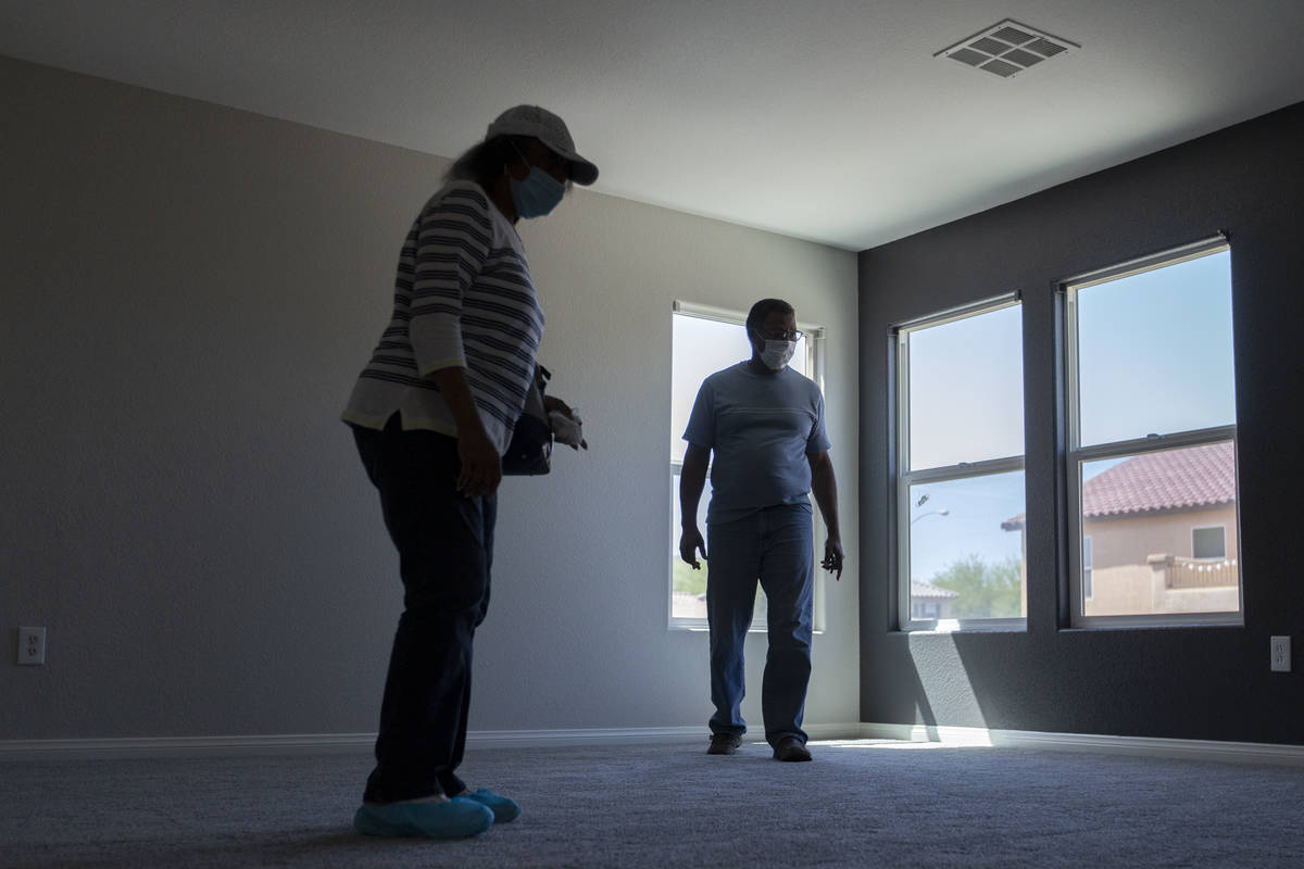 Evelyn Williams and Daryl Williams view the second floor during an open house at 2412 Craggy Le ...