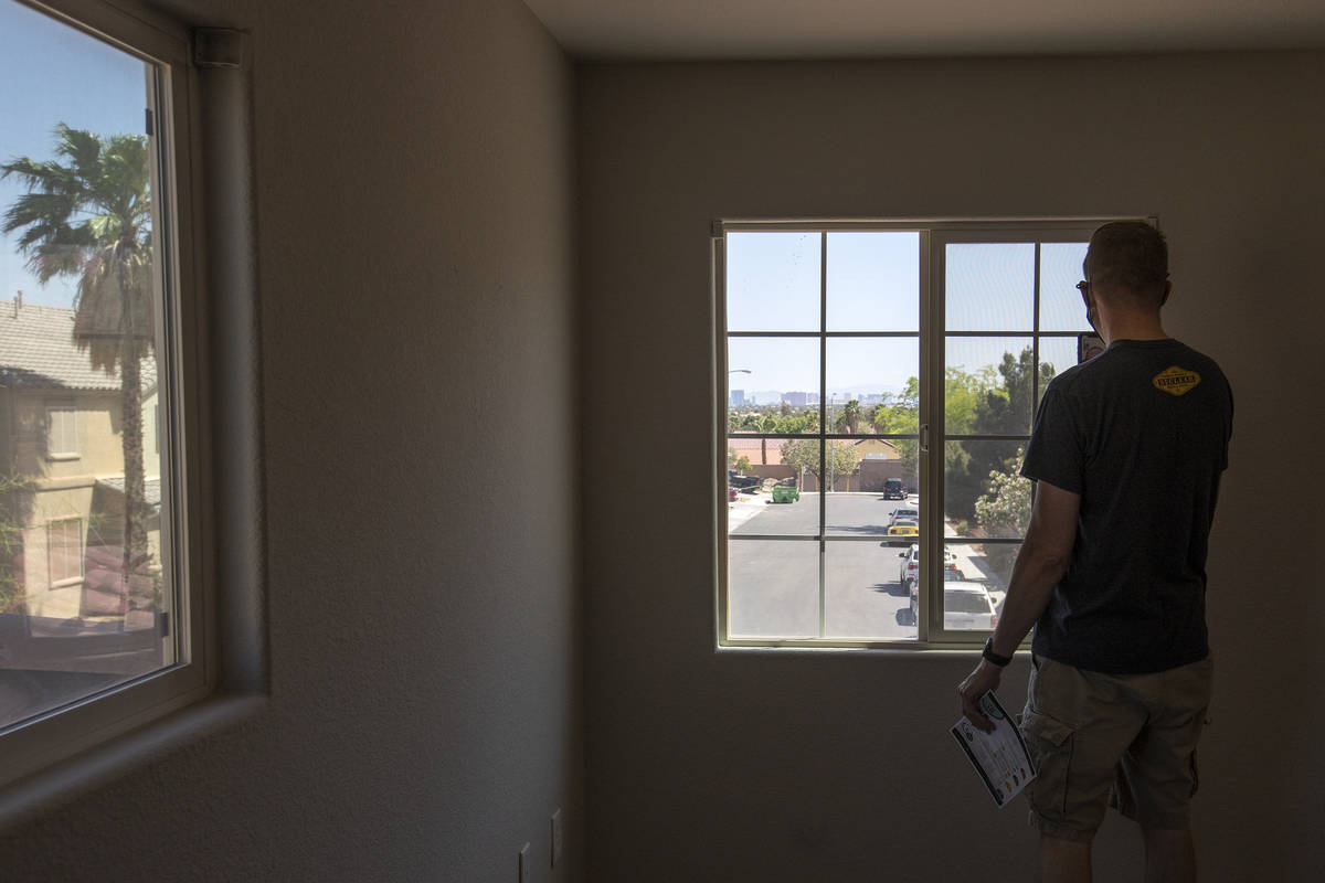 Joshua Winningham video chats with his wife, noting the view of the Las Vegas Strip, during an ...