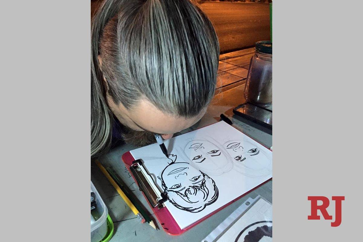 Larime Taylor works on a drawing in front of the Bellagio fountains in 2018. Taylor, who is dis ...