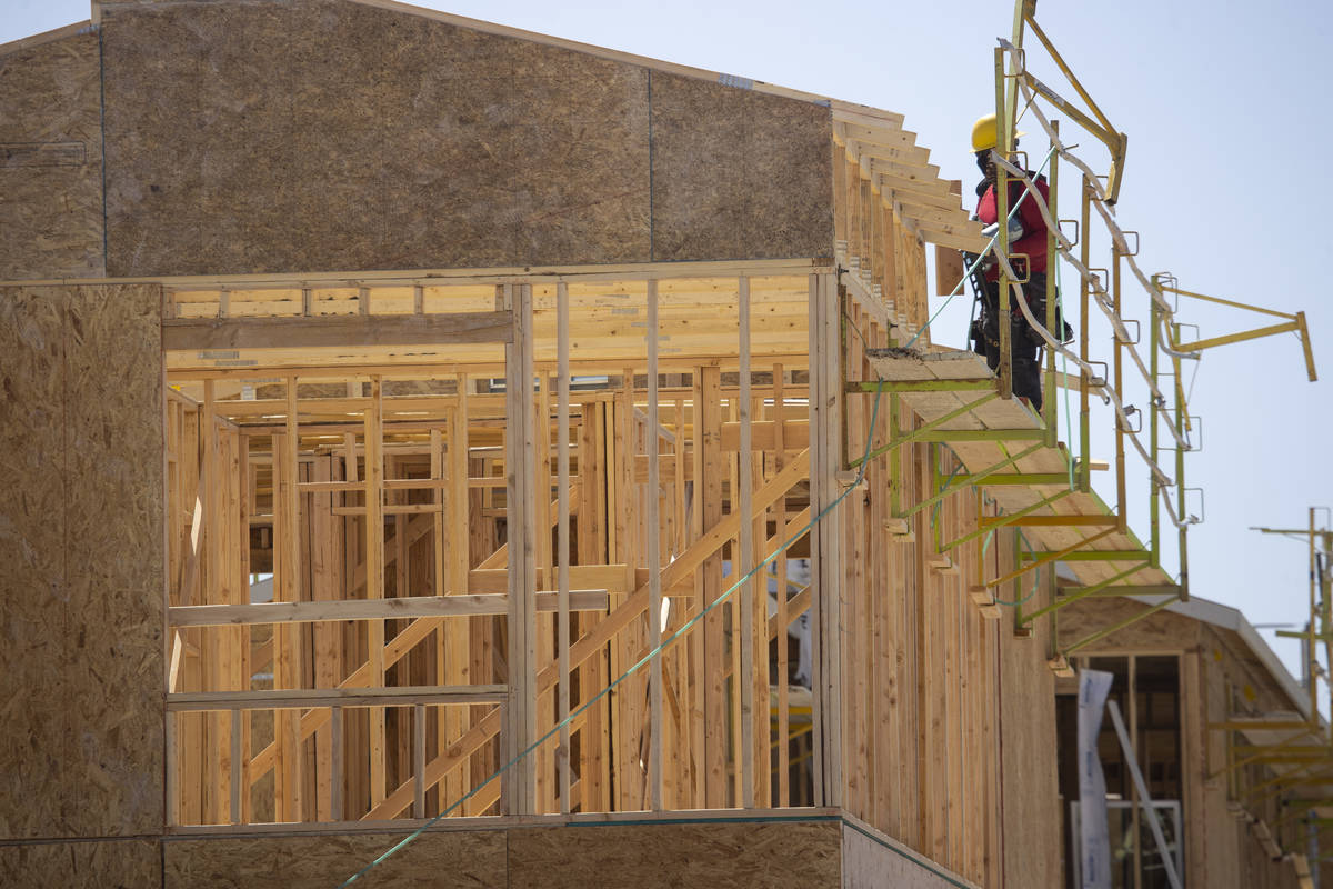 A construction worker build the roof of a home near W Elkhorn Road and N Aviary Way in North La ...