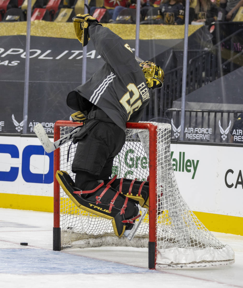 Golden Knights goaltender Marc-Andre Fleury (29) leaps to catch a puck during the warm-up perio ...