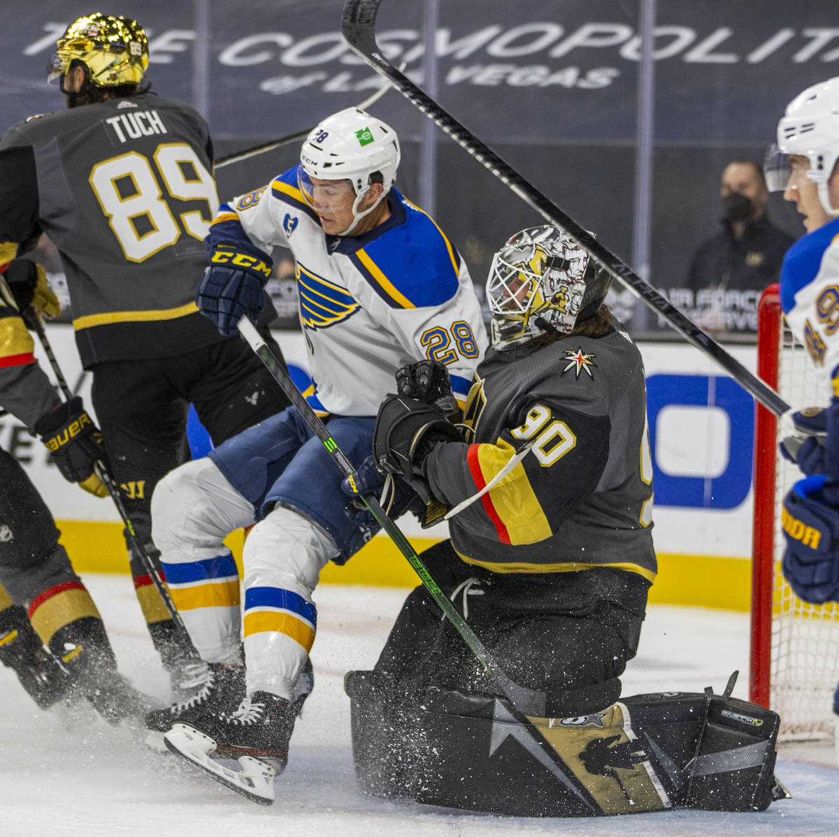 Golden Knights goaltender Robin Lehner (90) pushes St. Louis Blues left wing Mackenzie MacEache ...