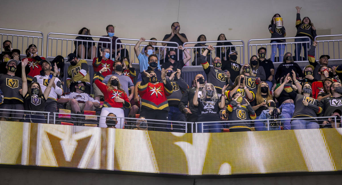 Golden Knights fans celebrate the first goal of the night versus the St. Louis Blues during the ...